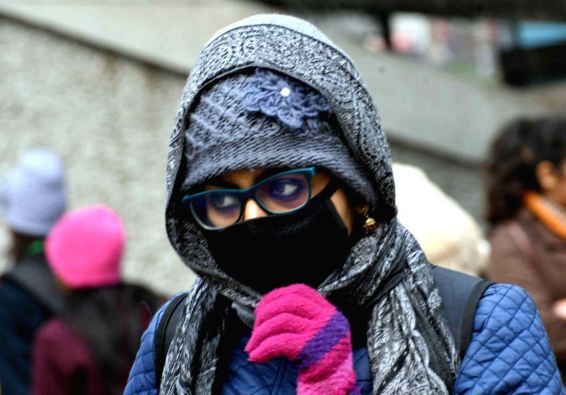 Woman wearing mask. (File Photo: IANS)
