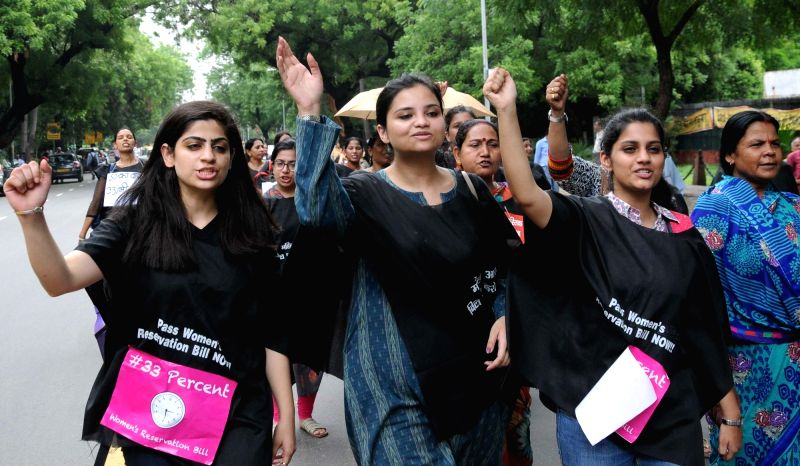 Women activists participate in a protest rally demanding the passing of the Women's Reservation Bill during the Monsoon Session of Parliament in New Delhi, on July 18, 2016.