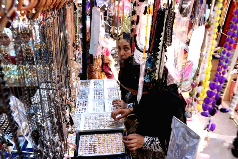 Women busy shopping ahead of Eid in Srinagar, on June 13, 2018.