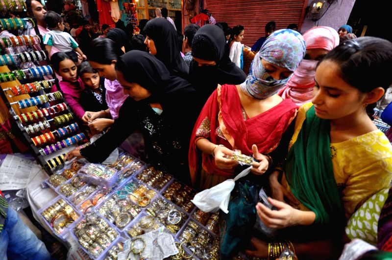 Women busy shopping ahead of Eid-ul-Fitr in Jaipur on July 25, 2014.