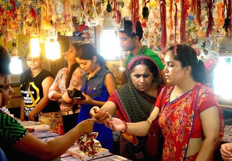 Women busy shopping ahead of Raksha Bandhan in Jaipur on Aug 8, 2014.