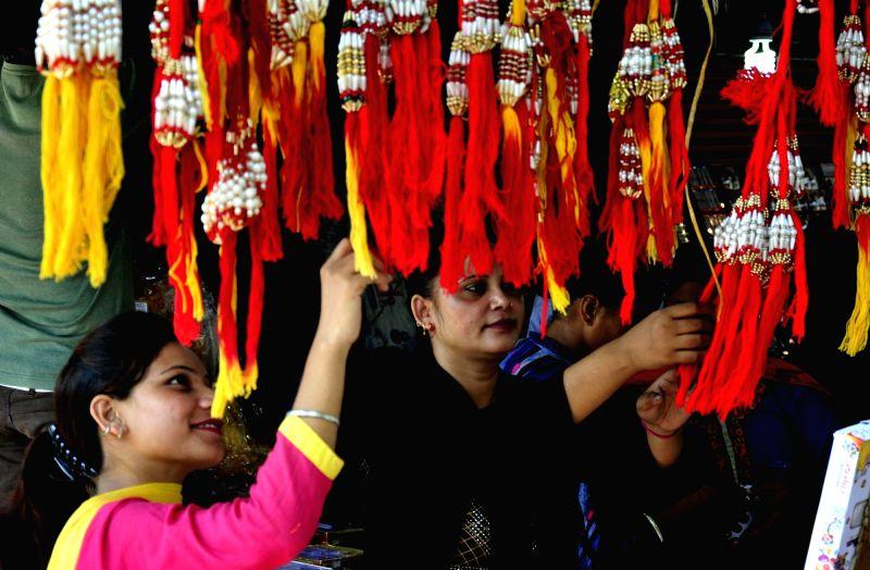 Women busy with Rakhi shopping ahead of Raksha Bandhan in Amritsar on Aug 5, 2017.