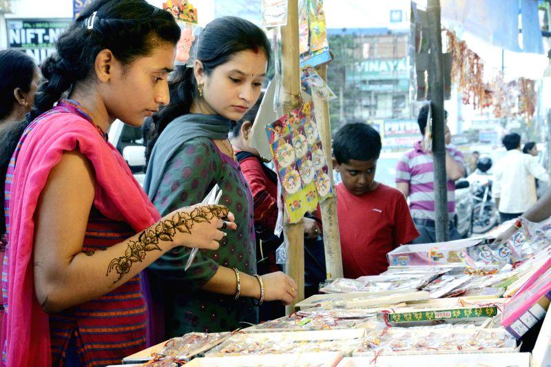 Women buy rakhis on the eve of Raksha Bandhan in Patna on Aug. 9, 2014.