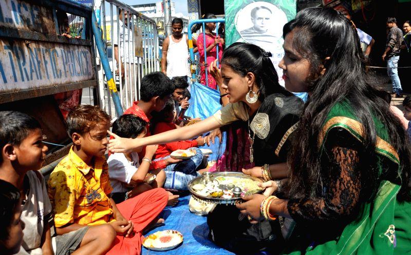 Women celebrate Bhai Dooj in Kolkata.