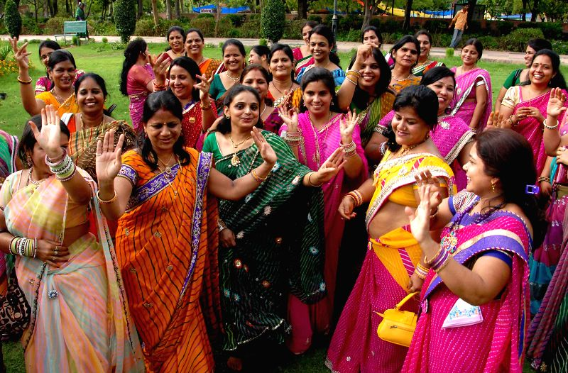 Women celebrate the Sawan Utsav at Jawahar Circle in Jaipur on July 22, 2014.