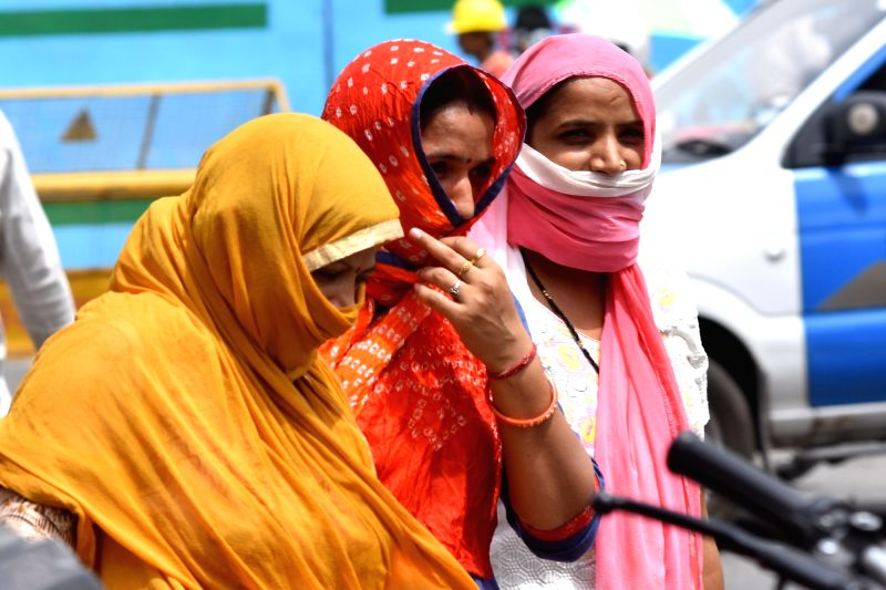 Women cover themselves to avoid scorching sun on a hot day in Jaipur, on June 8, 2018.