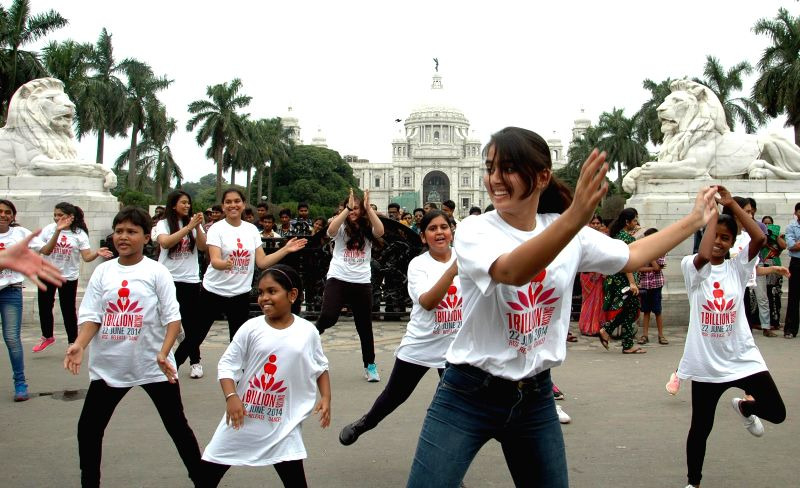Women dance in front of Victoria Memorial as they participate in 'One Billion Rising campaign' in Kolkata on June 22, 2014.