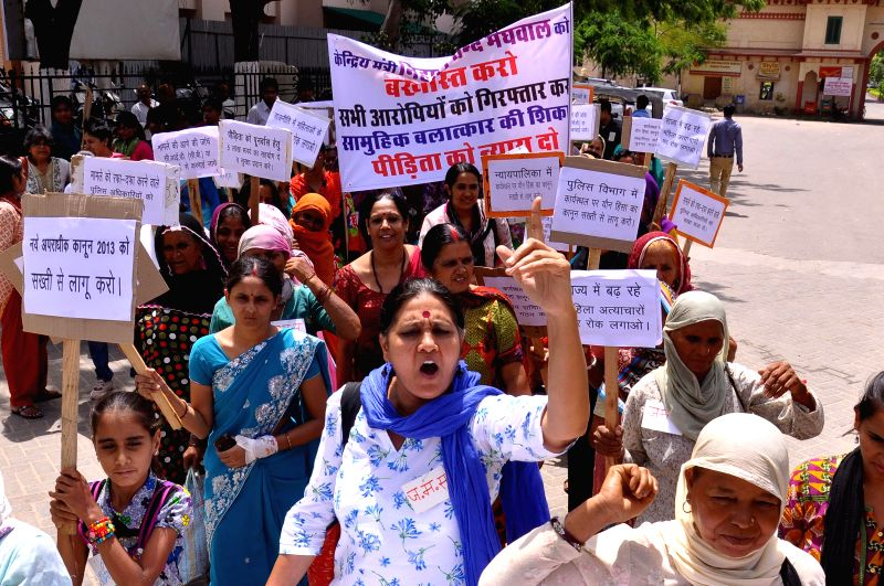 Women demonstrate against Union Minister Nihal Chand Meghwal who is facing rape charges in Jaipur on Aug 20, 2014.