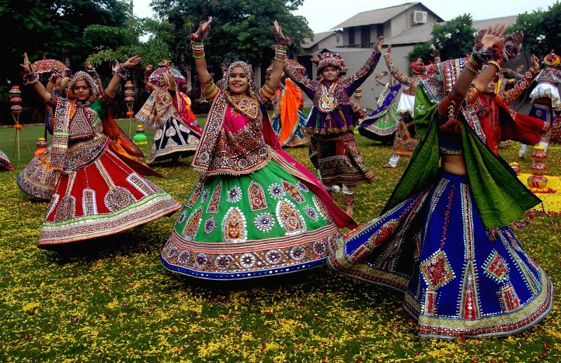 Women dressed in their traditional attire during Garba rehearsals ahead of Navratri.