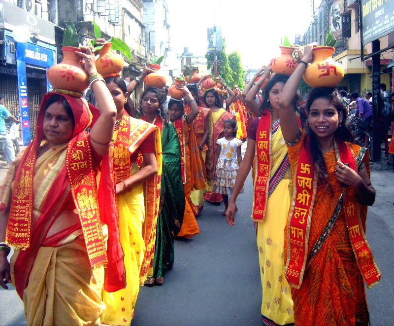 Women during a religious procession ahead of Hanuman Jayanti in Malda of West Bengal on April 13, 2014.
