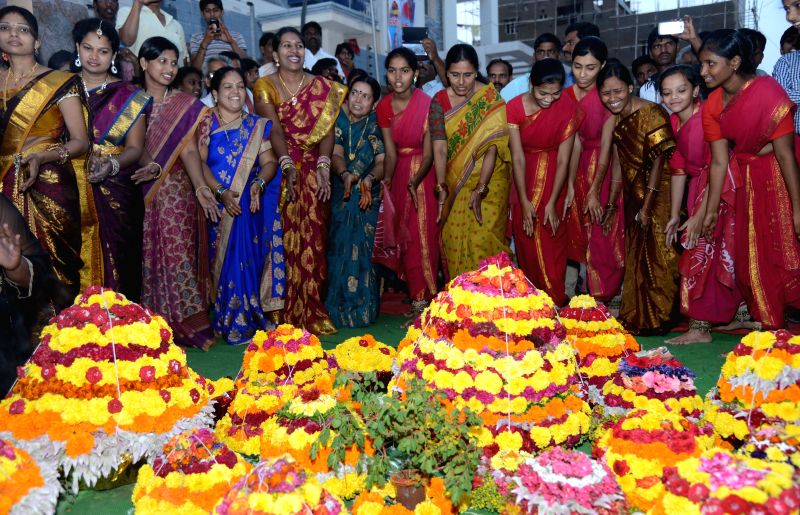Women participate during the `Bathukamma`, the floral festival of Telangana