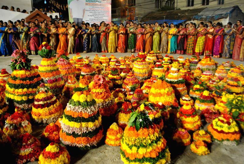 Women participate during the `Bathukamma`, the floral festival