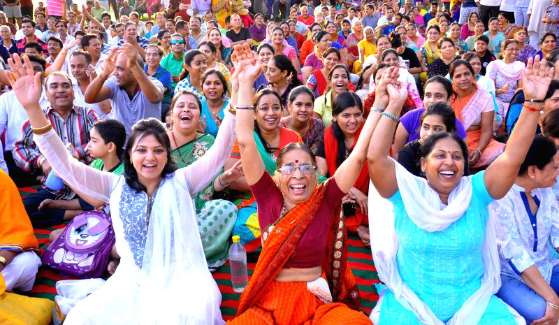 Women participate in a laughter yoga session organised on World Laughter Day at Central Park in Jaipur on May 4, 2014.