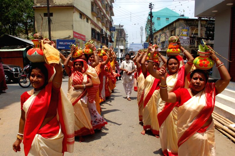 Women participate in a procession organised during Radha-Krishna Puja at English Bazar in Malda of West Bengal on May 4, 2014.