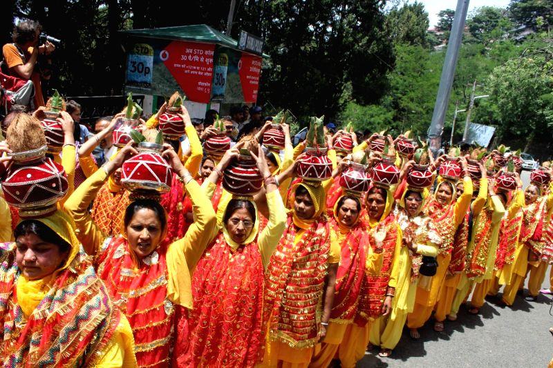 "Women participate in Devotees participate in ""Mangal Kalash Yatra"" a religious procession in Shimla on June 3, 2016."