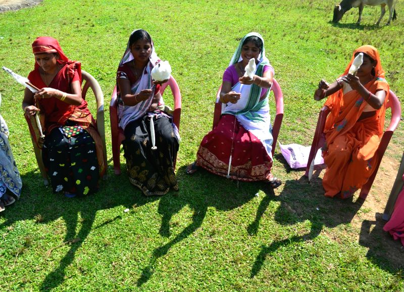 Women participate in Eri spinning competition organized by Rasomgram and Guldastan in Kamrup district of Assam on Nov 1, 2015.