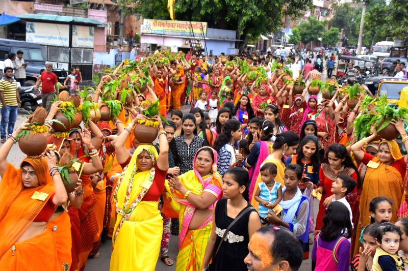 """Women participate in """"Kalash Yatra"""" in the month of """"Saawan"""" in Jaipur, on July 31, 2016."""