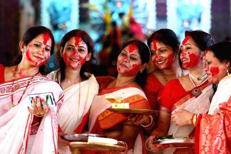 "Women participate in ""Sindoor Khela"" on Vijayadasami in Jaipur."