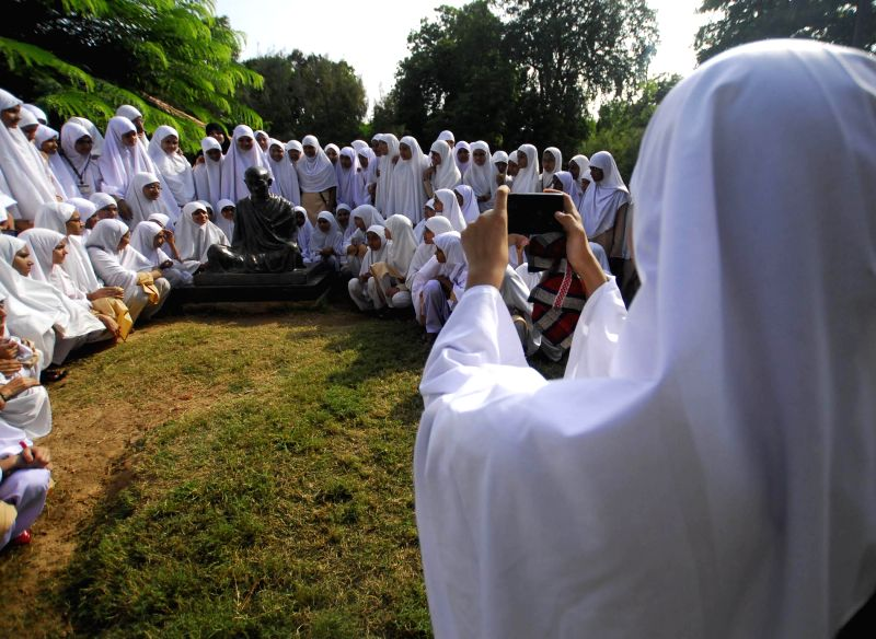 Women pay tribute to Mahatma Gandhi at Gandhi Ashram in Ahmedabad on Aug 21, 2014.