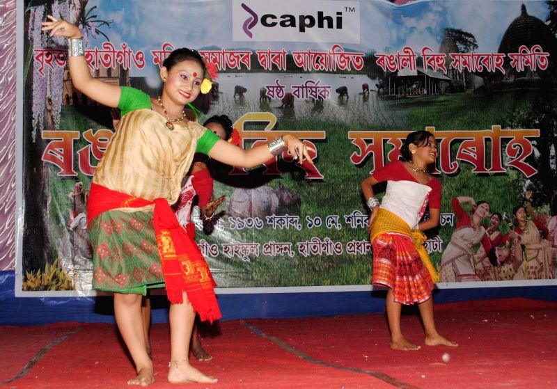Women perform Jheng Bihu during a Bihu proramme organised by Guwahati Mukali Bihu Sanmilan at Chandmari in Guwahati on May 11, 2014.