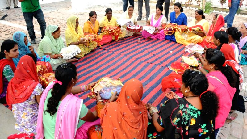 Women perform rituals after meeting with their husbands who are prisoners in Central Jail Amritsar as jail authorities made spacial arrangements on the occasion of `Karva Chauth` in ...
