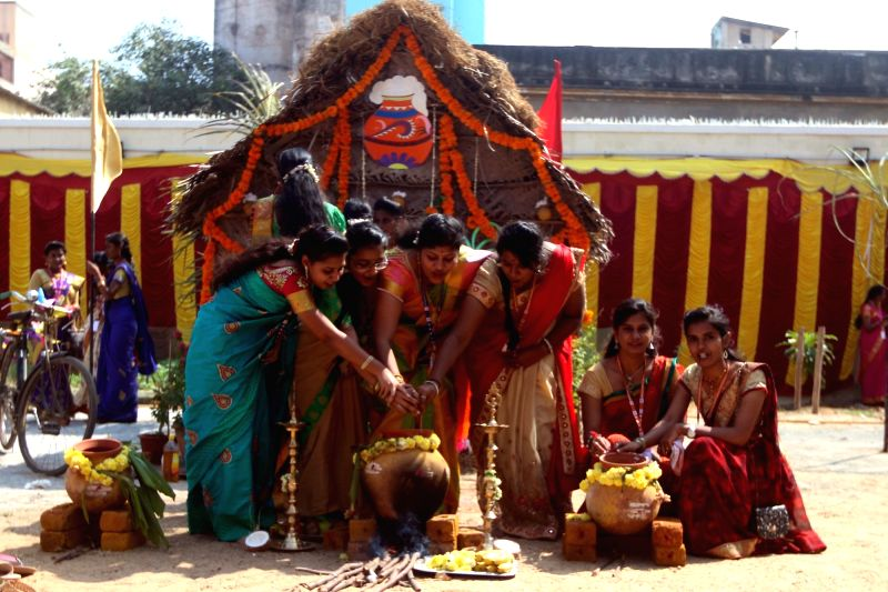 Women perform pongal rituals