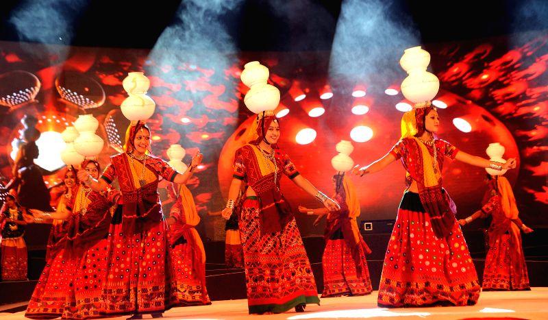 """Women practice """"Garba"""" ahead of Navratri in Ahmedabad."""