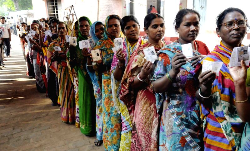 Women queue-up to cast his vote at a polling booth during the third phase of Bihar assembly polls in Patna on Oct 28, 2015.
