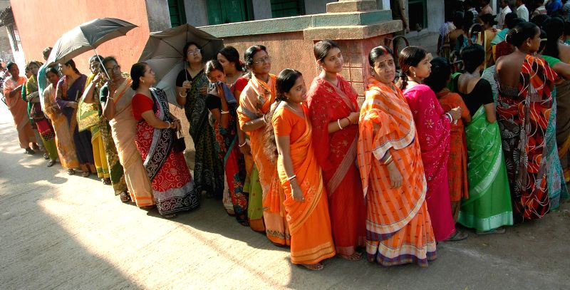 Women queue-up to cast their votes at a polling booth during the seventh phase of 2014 Lok Sabha Polls in Howrah of West Bengal on April 30, 2014.