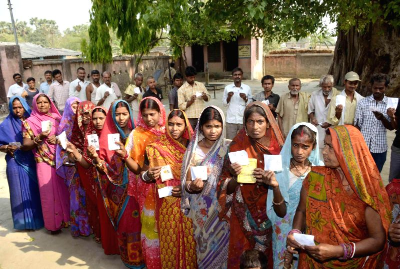 Women queue-up to cast their votes at a polling booth during the seventh phase of 2014 Lok Sabha Polls in Samastipur of Bihar on April 30, 2014.