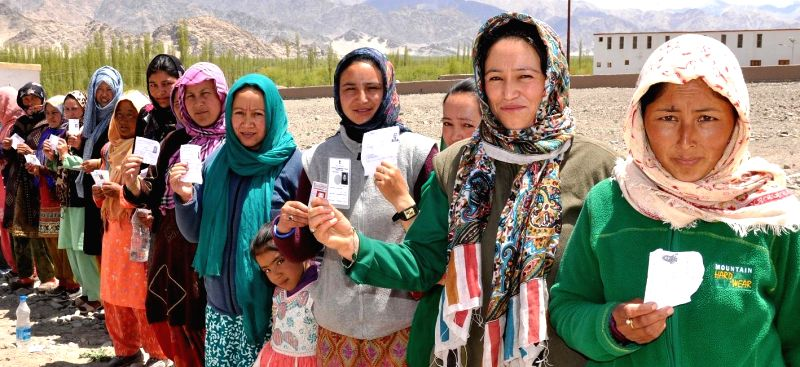 Women queue-up to cast their votes at a polling booth during the eighth phase of 2014 Lok Sabha Polls in Leh of Jammu and Kashmir on May 7, 2014.