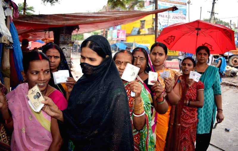 Women queue up to cast their votes at a polling booth during Patna Municipal Corporation elections on June 7, 2017.