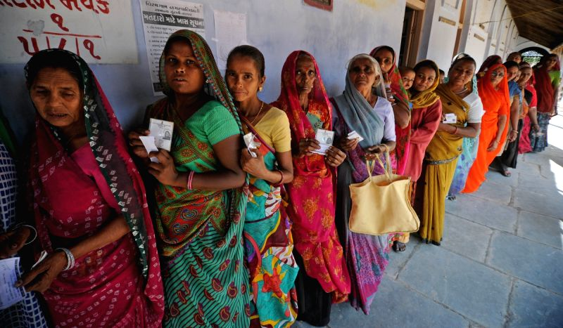 Women queue-up to cast their votes during Panchayat elections in Viramgam village near Ahmadabad on Nov 29, 2015.