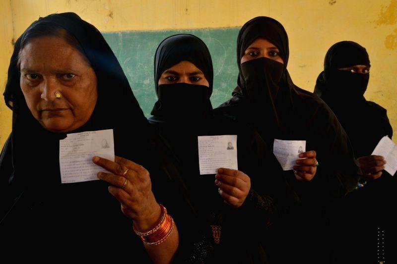 Women queue-up to cast their votes during bypolls in Ajmer Lok Sabha constituency in Rajasthan on Jan 29, 2018. In Ajmer, BJP leader Sanwarlal Jat's son Ramswaroop Lamba is contesting against ... - Raghu Sharma