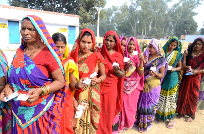 Women queue-up to cast their votes during Uttar Pradesh Panchayat polls on Dec 1, 2015.
