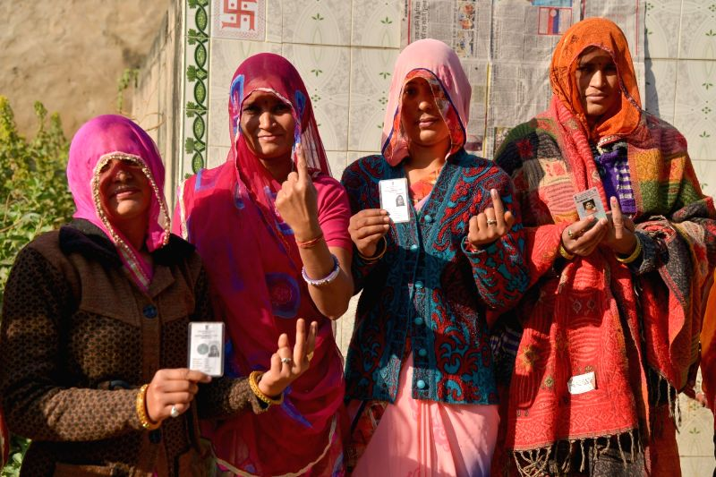 Women show their inked fingers after casting their votes for the Rajasthan Assembly elections, in Ajmer on Dec 7, 218.