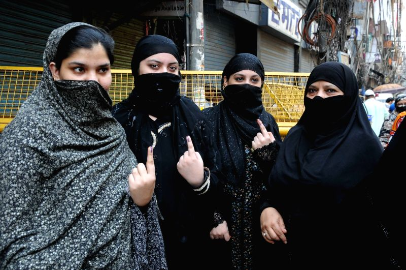 Women show their show their forefingers marked with phosphorous ink after casting vote at a polling booth during Municipal Corporation of Delhi (MCD) by-polls in New Delhi, on May 15, ...