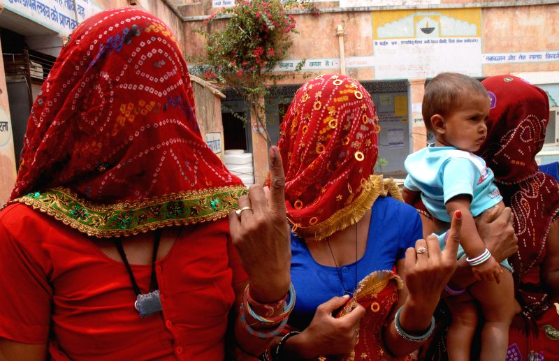 Women showing ink mark after casting their vote for Lok Sabha election at a polling station in Jaipur on April 17,2014.