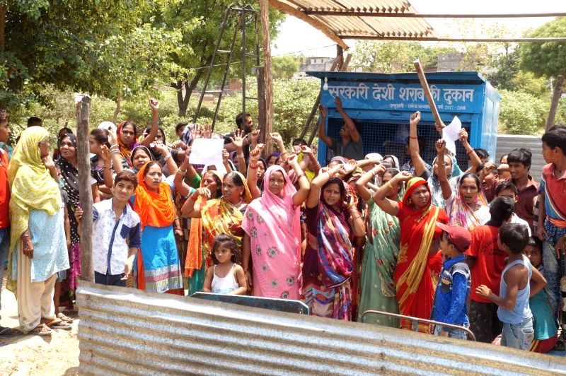 Women stage a demonstration to demand closure of a recently opened wine shop opened in Shivpur area of Varanasi alleging that it was causing nuisance in the village on May 18, 2017.