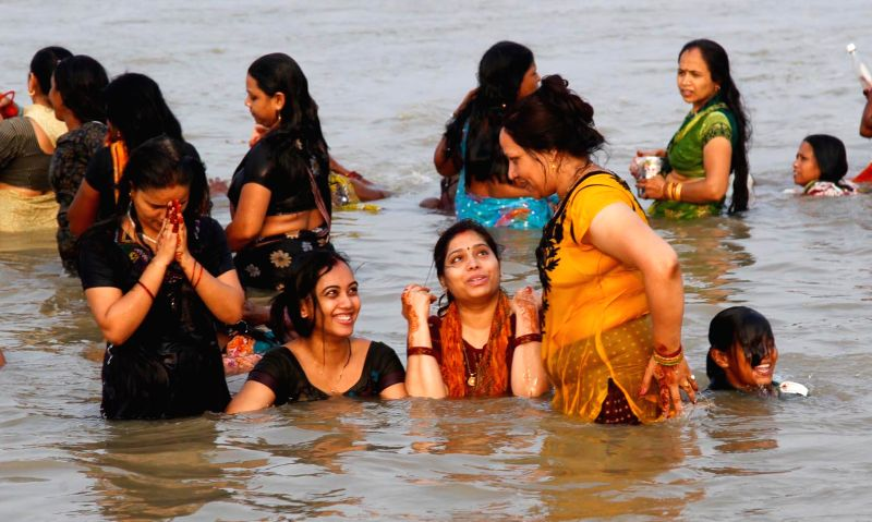 Women take holy dip in Sangam, on the occasion of Teej in Allahabad on Aug 28, 2014.