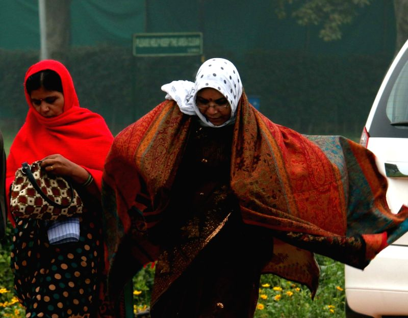 Women wearing warm clothes on a chilly morning in New Delhi.
