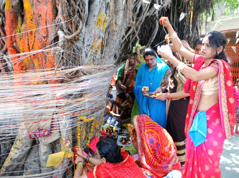 Women worship a banyan tree on Vat Purnima in Bhopal on May 25, 2017.