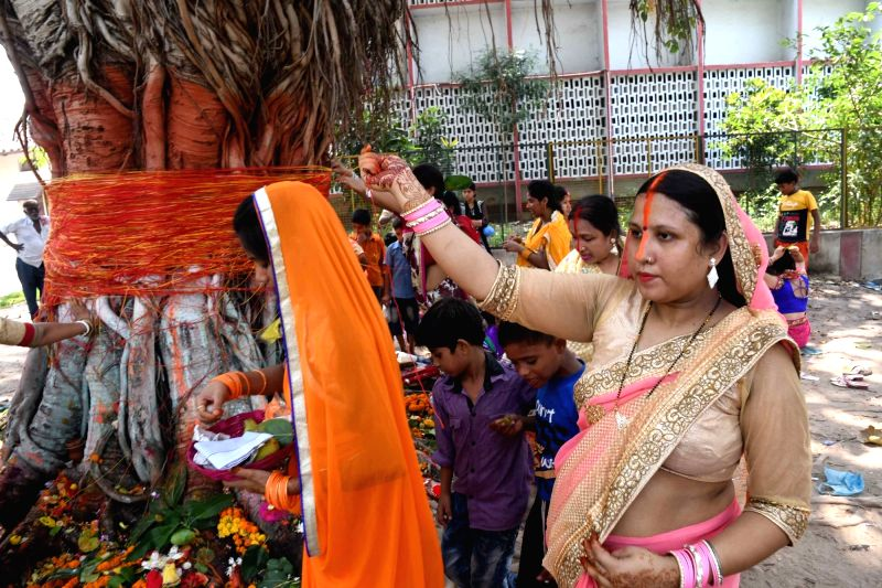 Women worship a banyan tree on Vat Purnima in Patna on May 25, 2017.