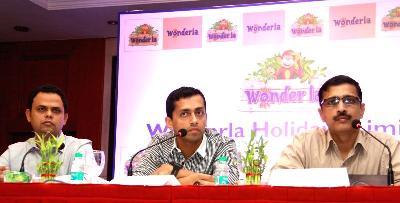 Wonderla Holidays Vice Presidents Amit Dalvi and Nandakumar T with MD of the organisation Arun K Chittilappilly during a press conference in Bangalore onApril 16, 2014.