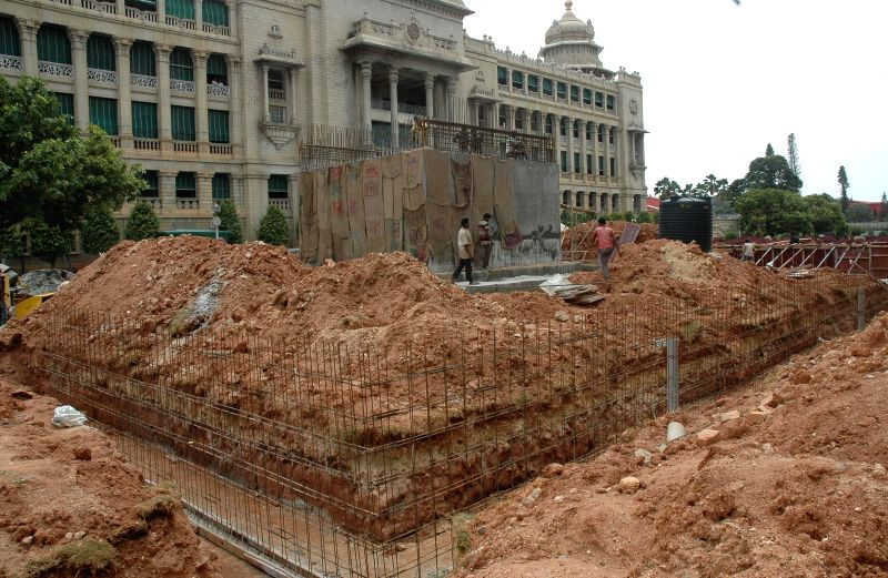 Work in progress at a fast pace to construct the Podium for the installation of Mahatma Gandhi Statue in between Vidhana Soudha and Vikasa Soundha, in Bangalore on Aug. 16, 2014.