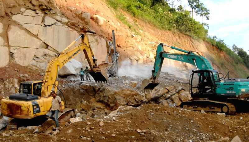 Work in progress on 80 km long all weather four lane road Jorabat-Shillong section between Guwahati and Shillong on July 6, 2014.