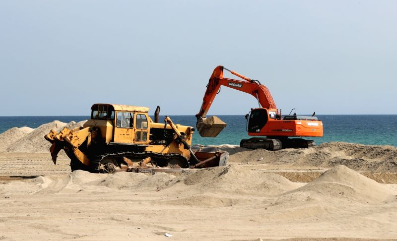 Work is under way at Gyeongpo Beach in Gangneung, an eastern coast city, to bring in clean sand on June 13, 2017. The beach is getting refurbished for its summer opening on July 1.