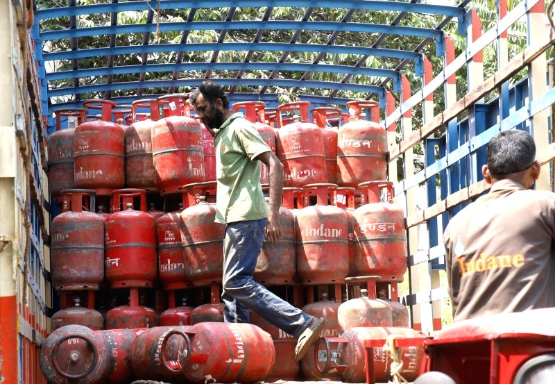 Workers arranging the domestic LPG cylinders at a  distributor unit, domestic LPG cylinder price hiking continually from last week, in Bengaluru on Tuesday 16th February 2021. (Photo: Dhananjay Yadav/IANS)
