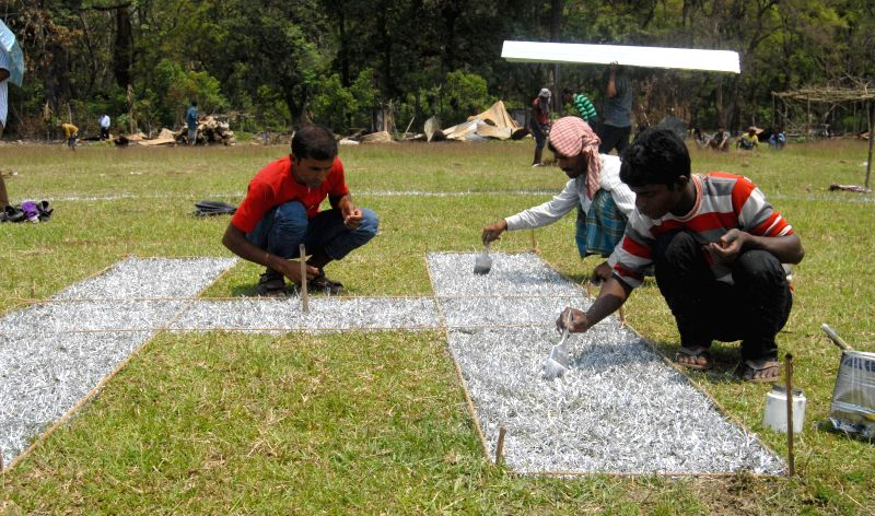 Workers build a temporary helipad at Narayanguri Relief Camp setup to provide shelter to those who fled their villages after recent violence in Bodoland Territorial Area Districts (BTAD), for Assam .. - Tarun Gogoi