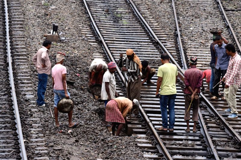 Workers busy in ongoing repair works on railway tracks. (File Photo: IANS)